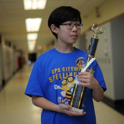 Seventh-grader Aaron Chang from the Audubon Elementary School with his trophy after winning annual Citywide Spelling Bee Championship at the Lindblom Math and Science Academy on March 14, 2019. He will represent Chicago Public Schools at the Scripps National Spelling Bee in Washington, D.C., where he will compete against the best spellers from across the nation for the title of 2019 national Spelling Bee Champion and an opportunity to win a $40,000 prize. | Victor Hilitski/For the Sun-Times
