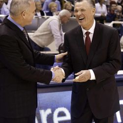 BYU Men's Basketball head coach Dave Rose speaks with Fresno State Basketball head coach Steve Cleveland before the game in the Marriott Center in Provo Utah on Friday.  The Cougars beat the Bulldogs 83-56.Luke Hansen11/12/10
