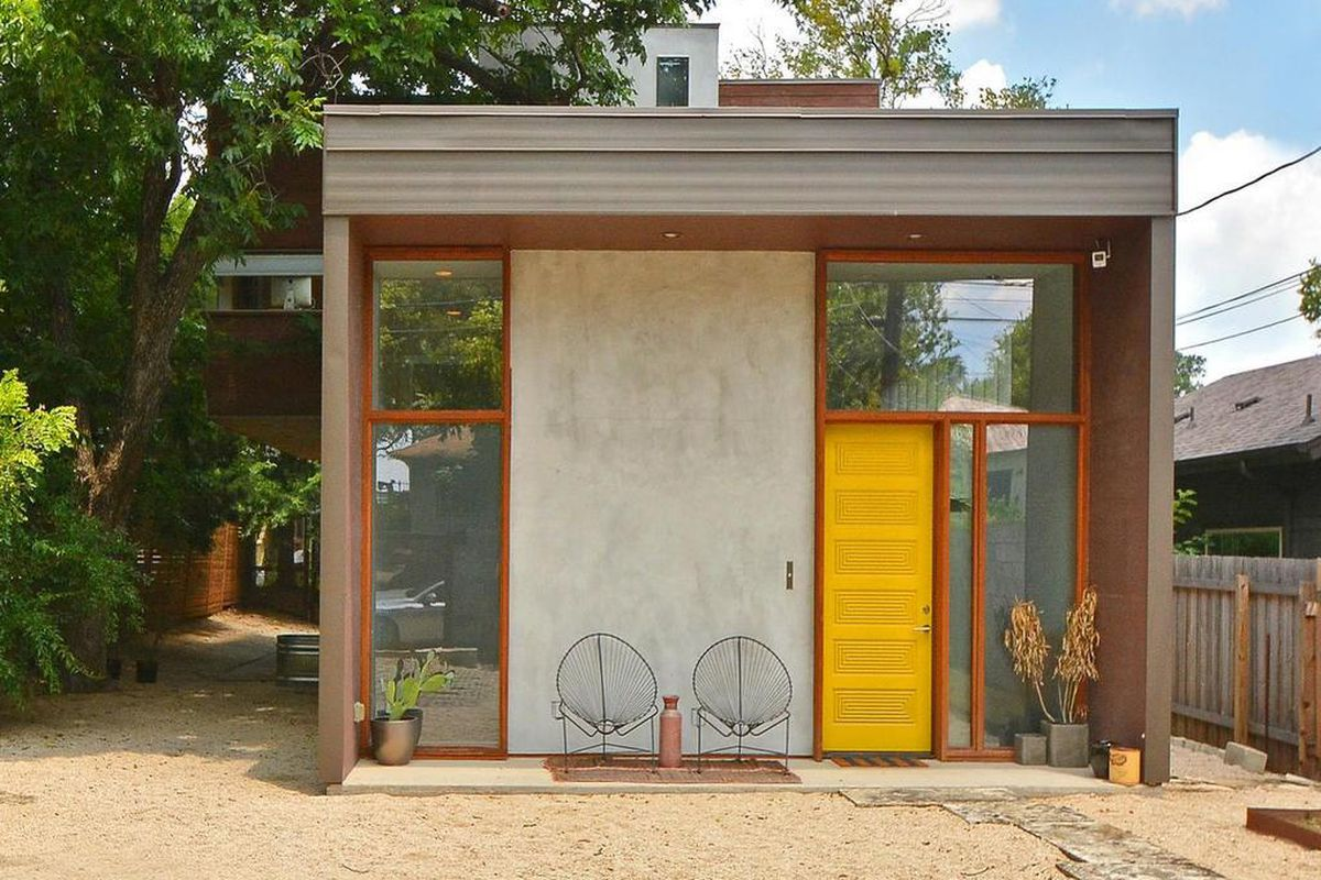 Rectangular-shaped entrance to home, concrete, wood, and CorTen/rusted metal
