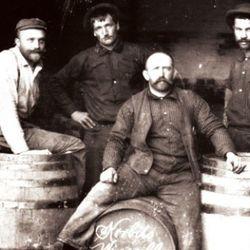 Frank Hasek - winemaker at Korbel - with his Cellar Crew, late 1800s. (Source: Korbel) By 1900 Hasek had established Korbel as an award-winning, internationally recognized sparkling wine label.<br />