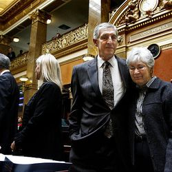 Recently retired Jazz coaches Jerry Sloan and Phil Johnson are honored in the House of Representatives at the Utah State Capitol on Monday, March 7, 2011. Gail Miller is comforted by Jerry Sloan as words by her late husband, Larry Miller, are recited.
