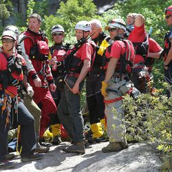 Members of Salt Lake County Search and Rescue and Unified Police Department take a break on Monday, June 5, 2017, during efforts to recover the body of a 22-year-old hiker who fell in Bell Canyon. Siaosi Brown's body was spotted in the lower falls of the canyon. His body was trapped on some logs in the middle of the waterfall, Unified Police Lt. Brian Lohrke said.