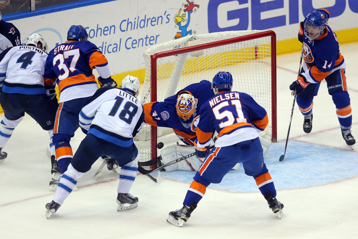 Jets #4 Paul Postma scores his first goal of the season.