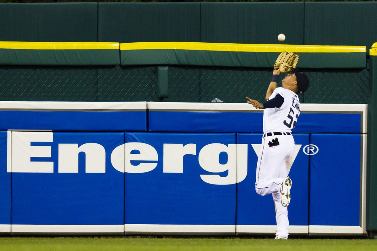 June 1, 2012; Detroit, MI, USA; Detroit Tigers center fielder Quintin Berry (52) catches a fly ball hit by New York Yankees designated hitter Andruw Jones (22) during the sixth inning at Comerica Park. Mandatory Credit: Rick Osentoski-US PRESSWIRE