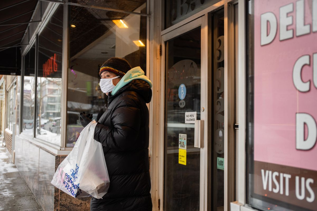 A customer exits Dinkel's Bakery Saturday afternoon with an armload of goods.