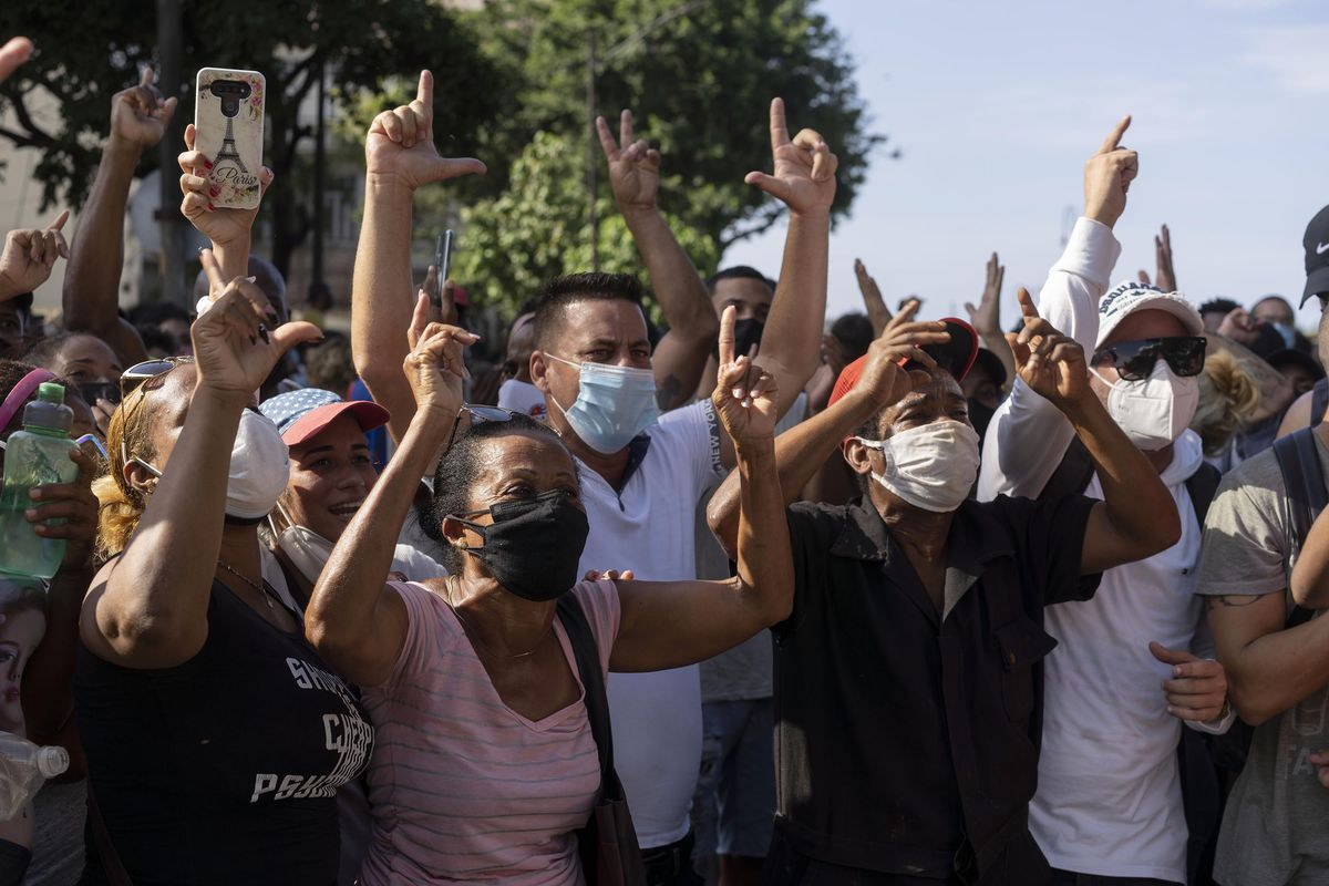 Anti-government protesters march in Havana, Cuba, on Sunday, July 11, 2021.