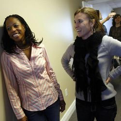 Saratoga Springs Mayor Mia Love, left, and friend and campaign volunteer Jessica Stanford laugh as they talk after the interview Thursday, Dec. 22, 2011 about Mia's plans to run for Congress at what will become her campaign headquarters in South Jordan.
