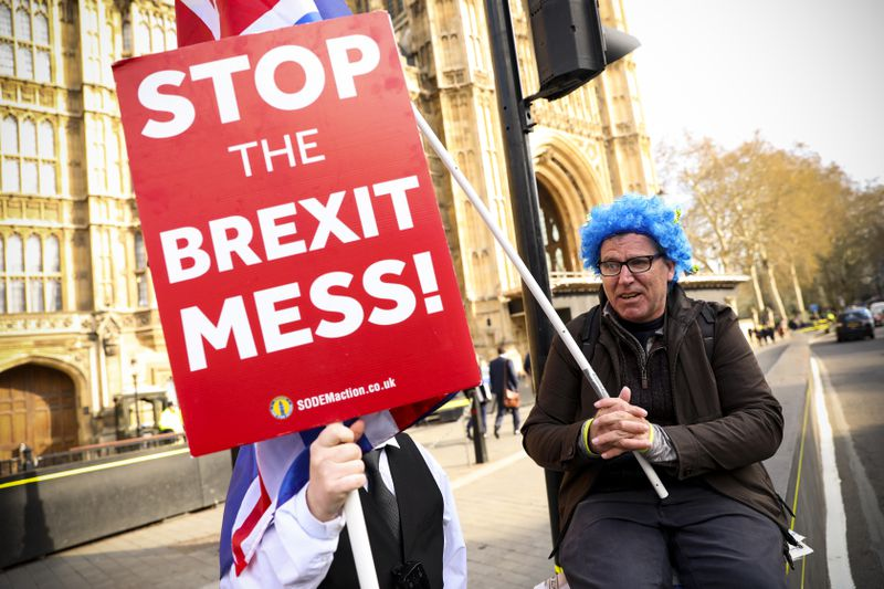 Anti-Brexit activists demonstrate outside of the Houses of Parliament in central London on April 3, 2019.