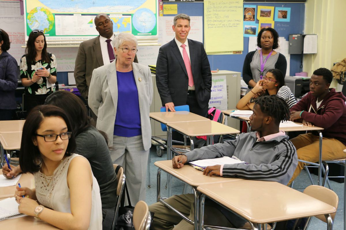 Fariña visited a classroom with Deputy Mayor Richard Buery (left) and Chris Caruso (center), who heads the education department's new community schools office.