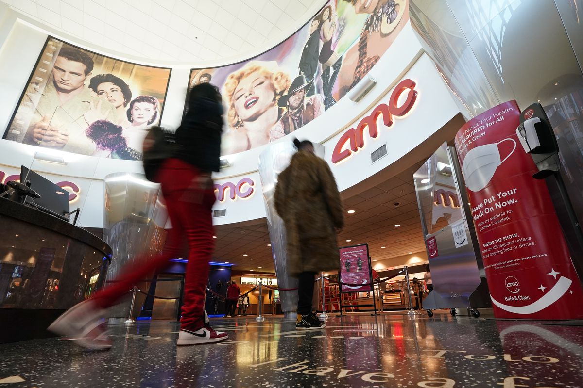 Movie patrons arrive to see a film at the AMC 16 theater in Burbank, California.