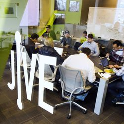 Employees attend a lunch meeting at Jive Communications in Lindon on Friday, March 10, 2017.
