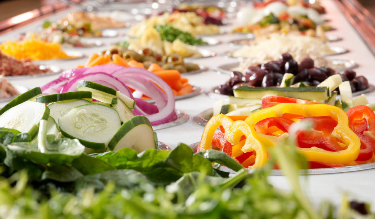 A salad bar stocked with a variety of ingredients.