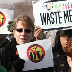 A small but vocal group takes part in the protest, where HEAL Utah's Christopher Thomas said a waste storage compromise worked out between Gov. Gary Herbert and the U.S. Department of Energy is inadequate.