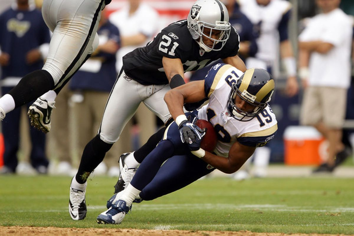 OAKLAND CA - SEPTEMBER 19:  Laurent Robinson #19 of the St. Louis Rams is tackled by Nnamdi Asomugha #21 of the Oakland Raiders at the Oakland-Alameda County Coliseum on September 19 2010 in Oakland California.  (Photo by Ezra Shaw/Getty Images)
