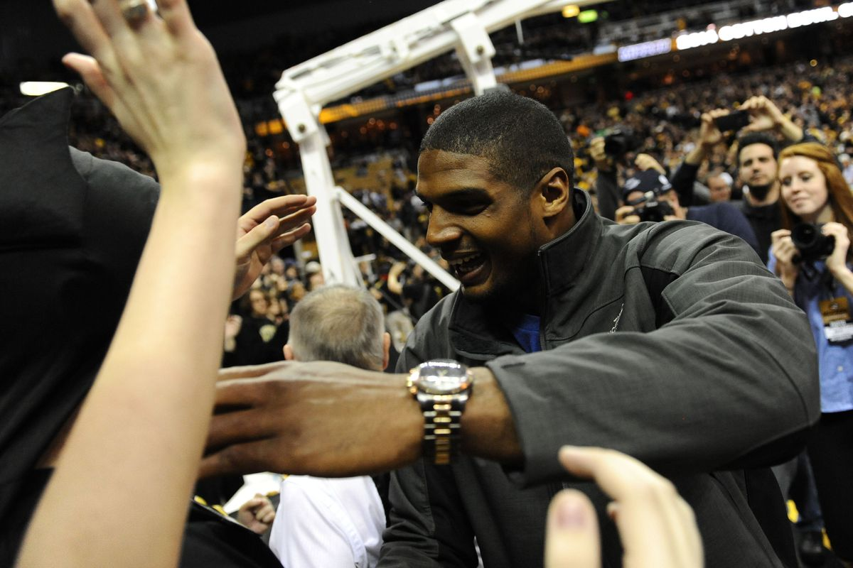 Michael Sam greets fans at the Missouri basketball game.