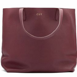 This <b>Cuyana Leather Tote </b>is the perfect stylish carryall bag. It's great for the new mom who fills it with bottles and diapers, to a seasoned mom who's shuffling the kids to soccer practice. The soft, lightweight leather bag is perfectly minimalist