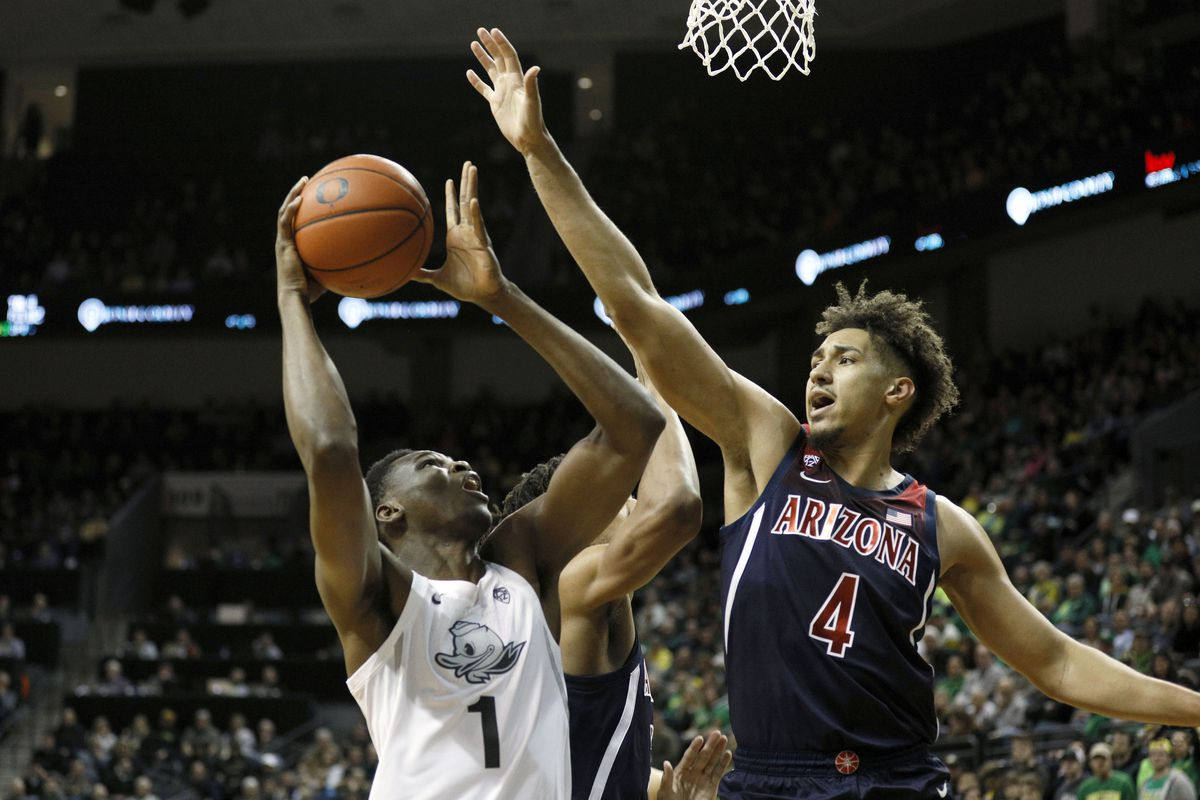 Oregon Ducks center N'Faly Dante shoots the ball against Arizona Wildcats center Chase Jeter during the first half at Matthew Knight Arena.