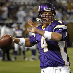 Minnesota Vikings quarterback Brett Favre warms-up prior to an exhibition NFL football game against the Kansas City Chiefs, Friday.