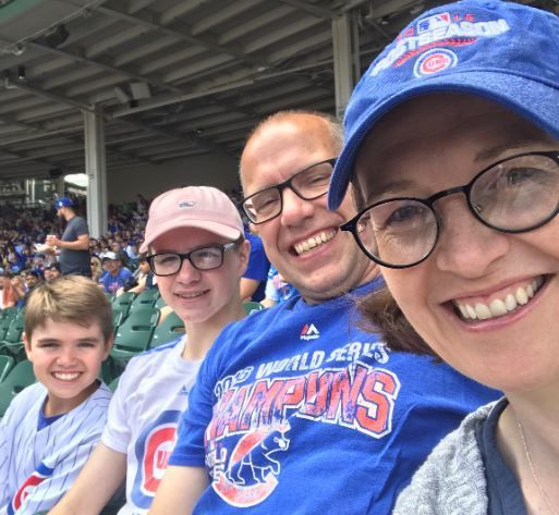 Julia Lynch (right), with husband John and two of their sons, used 325,000 miles to book five plane tickets for a baseball-themed family vacation. Canceling proved trickier.