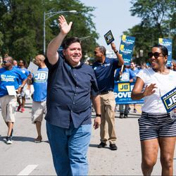JB Pritzker and Juliana Stratton walk in the Bud Billiken Day Parade on August 11, 2018.   Max Herman/For the Sun-Times