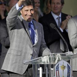 European team captain Jose Maria Olazabal waves as he walks up to the podium during the opening ceremony at the Ryder Cup PGA golf tournament Thursday, Sept. 27, 2012, at the Medinah Country Club in Medinah, Ill.