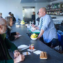 Erik Adkins talks to customers at the bar.