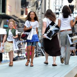 <em>Image via Getty</em><br /><br />Tourists and even a few Express-crazed New Yorkers walked the runway.