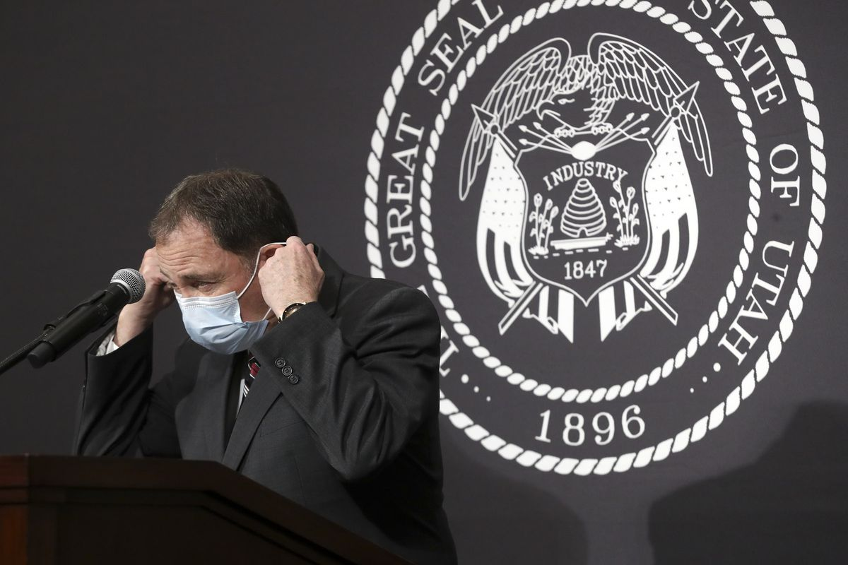 Gov. Gary Herbert removes his mask before speaking during the daily COVID-19 briefing at the Capitol in Salt Lake City on Friday, April 24, 2020.