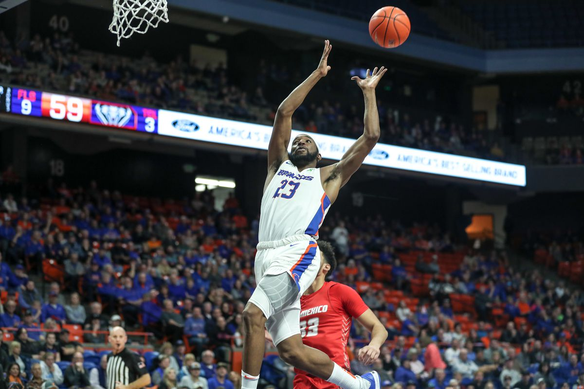 Guard RJ Williams of the Boise State Broncos catches an alley-oop pass enroute to a slam dunk during second half action against the New Mexico Lobos at ExtraMile Arena on February 23, 2020 in Boise, Idaho.
