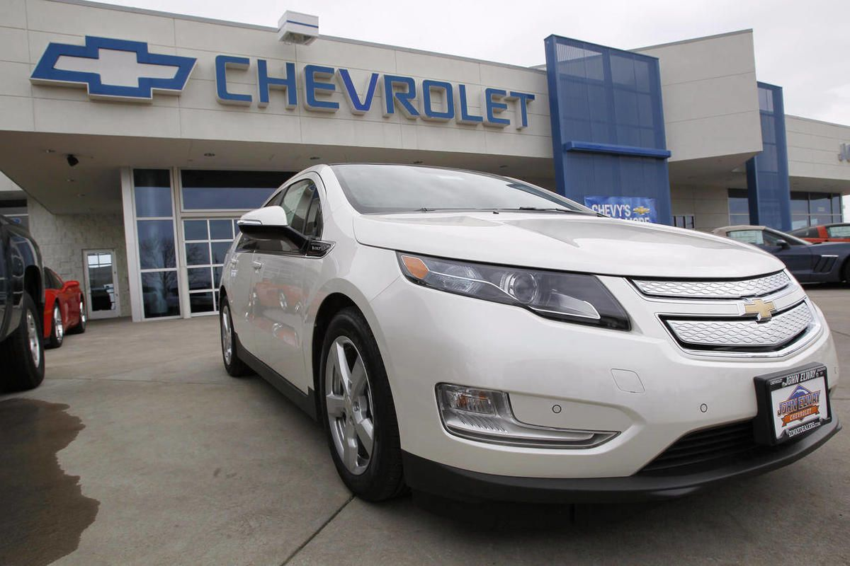 FILE - This Feb. 19, 2012 file photo, shows a 2012 Chevrolet Volt at a Chevrolet dealership in the south Denver suburb of Englewood, Colo. Sales of the Volt set a monthly record of 2,800 in August, mostly because of steep discounts.