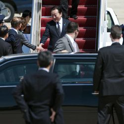 Japanese Prime Minister Yoshihiko Noda, center, arrives at Andrews Air Force Base, Md., Sunday, April 29, 2012. President Barack Obama will meet with Noda at the White House, Monday, April 30, 2012.