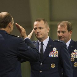 Brig. Gen. Carl Buhler assumes command during a change of command ceremony at Hill Aerospace Museum, Monday, Sept. 8, 2014. Brig. Gen. Carl A. Buhler assumed command of the Ogden Air Logistics Complex from Maj. Gen. H. Brent Baker, Sr.