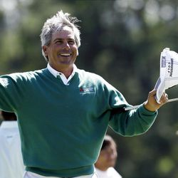 Fred Couples celebrates after finishing Friday's second round of the Masters golf tournament in a tie for the lead with Jason Dufner.