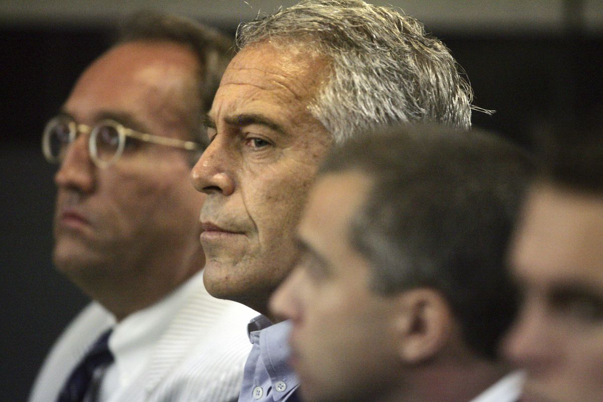 FILE - In this July 30, 2008 file photo, Jeffrey Epstein, center, appears in court in West Palm Beach, Fla.