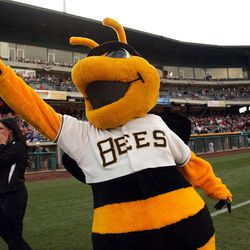 Bumble cheers on a fan during a contest  as the Salt Lake Bees open the season at home  in Salt Lake City  Friday, April 13, 2012.