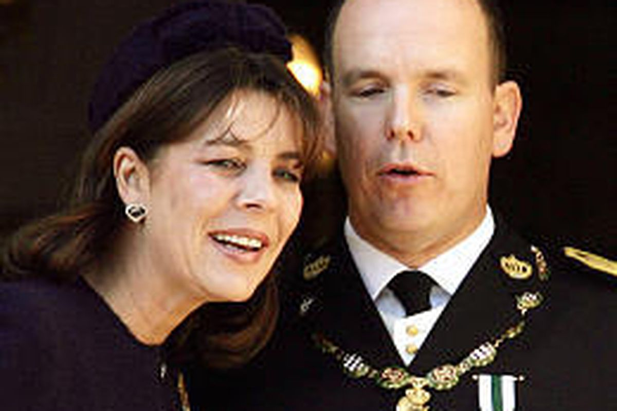 Prince Albert II of Monaco and his sister Princess Caroline of Hanover are seen at the Monaco Palace where he assumed Monaco's throne.