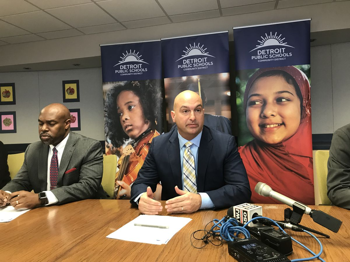 Detroit Superintendent Nikolai Vitti, right, speaks during a news conference Wednesday. He's shown here with Desmond Blackburn, the CEO of The New Teacher Center.