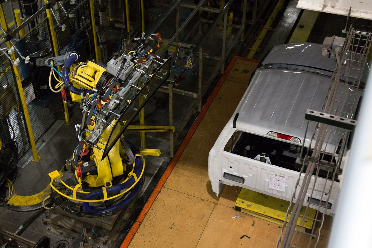 The body of a new F-150 meets its new rear windshield on the assembly line.