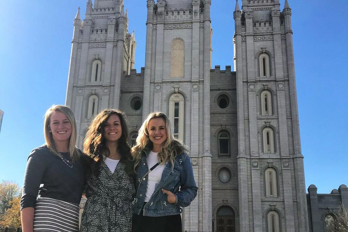 Morgan Jones (middle) smiles for a photo in front of the Salt Lake Temple with friends McKenzie Gummersall and Chelsie Hightower following a temple worker devotional.