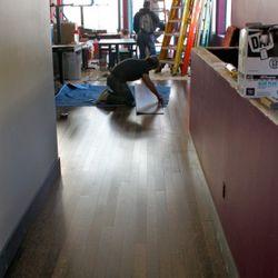 Putting in the eco-friendly duraplam flooring last week