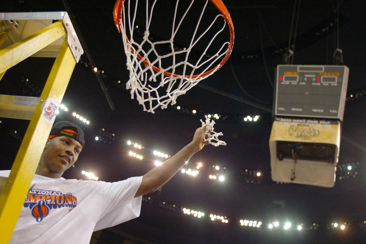 Anthony cuts down the net
