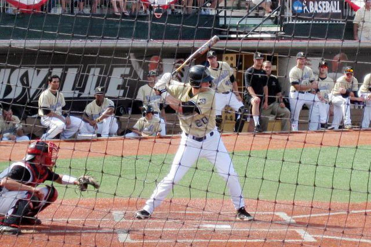 Connor Harrell's safety squeeze - his first hit against Louisville in the Regional - drove home the winning run for the Commodores.