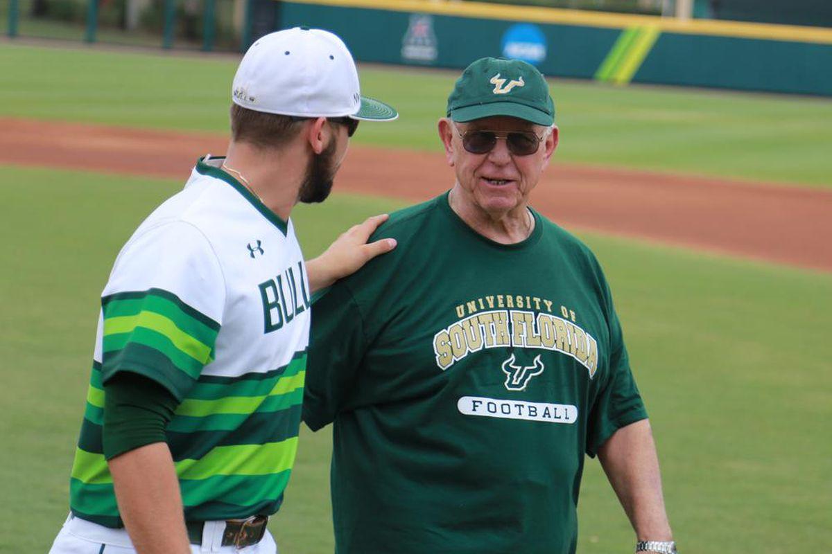 After 50 years at USF, Tomaino still shows up at a baseball game in a football shirt.