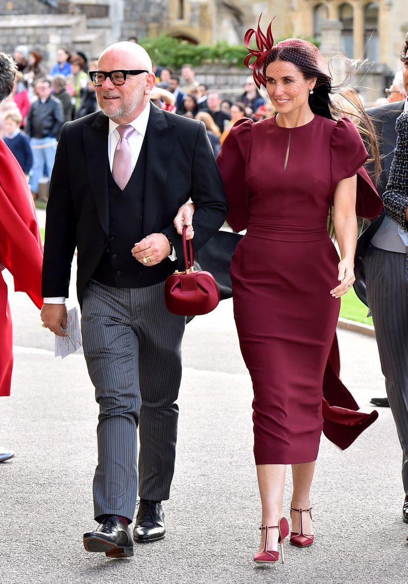 Demi Moore wears a burgundy dress.