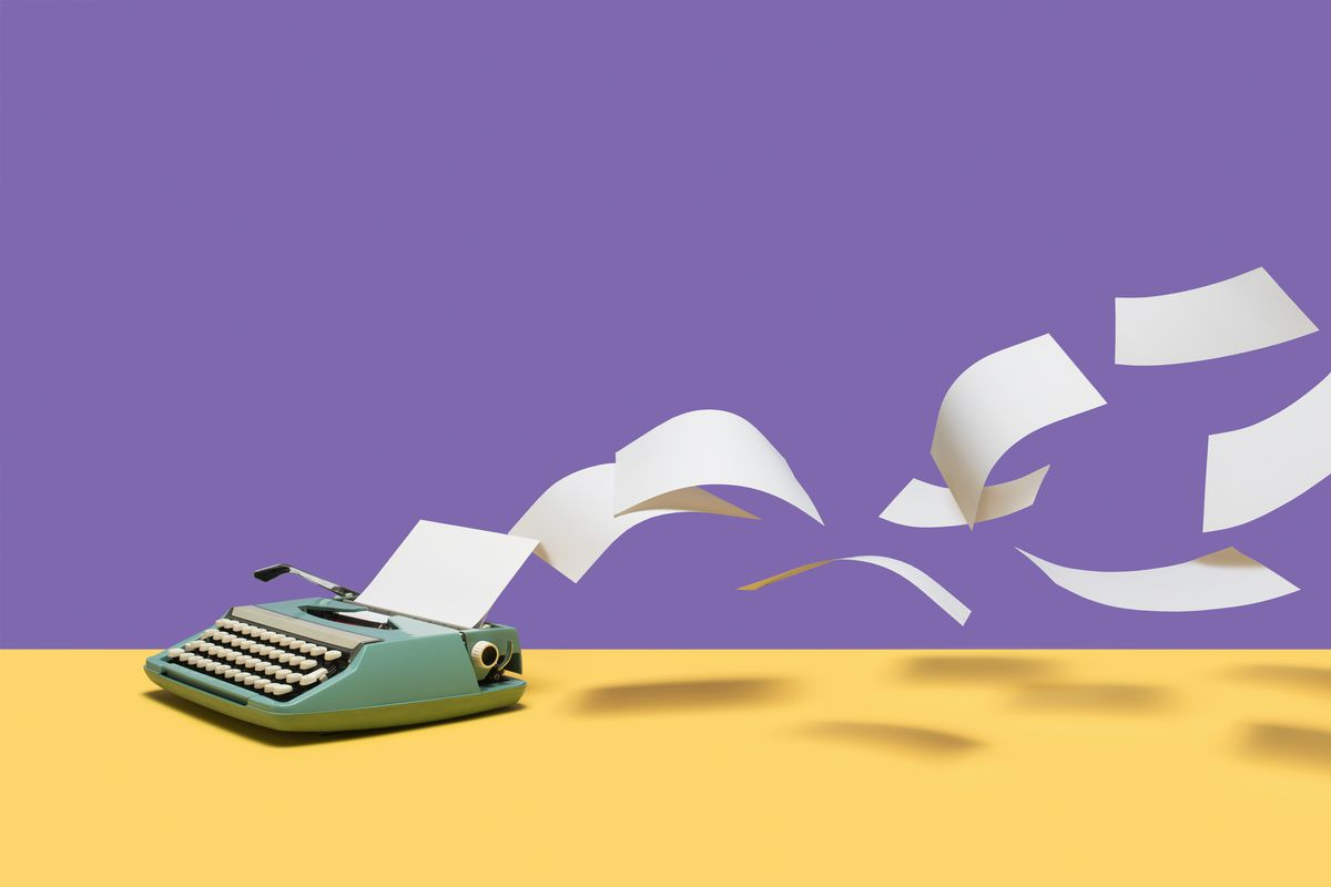 An illustration of a manual typewriter with pages of paper flying out of it.