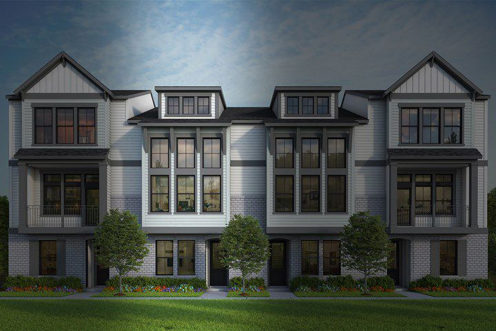 A series of white brick townhomes.