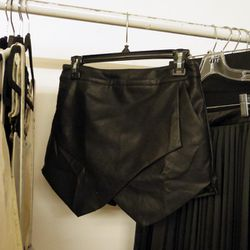 """A leather origami skirt from <a href=""""www.faubourgdutemple.com/"""">Faubourg Du Temple</a>'s S/S 2014 collection"""