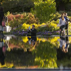 Taking photos at the reflecting pond near the Salt Lake Temple prior to the morning session of the 183rd Semiannual General Conference for The Church of Jesus Christ of Latter-day Saints Sunday, Oct. 6, 2013, inside the Conference Center.