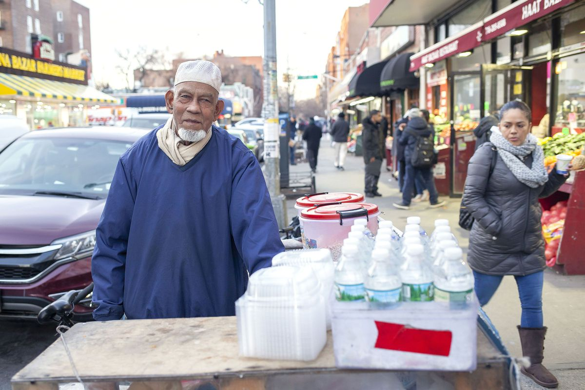 Sanwar Ahmed now has a much smaller food stand in Jackson Heights after city officials took his larger food cart, Feb. 28, 2019.  Photo credit: Ben Fractenberg/THE CITY