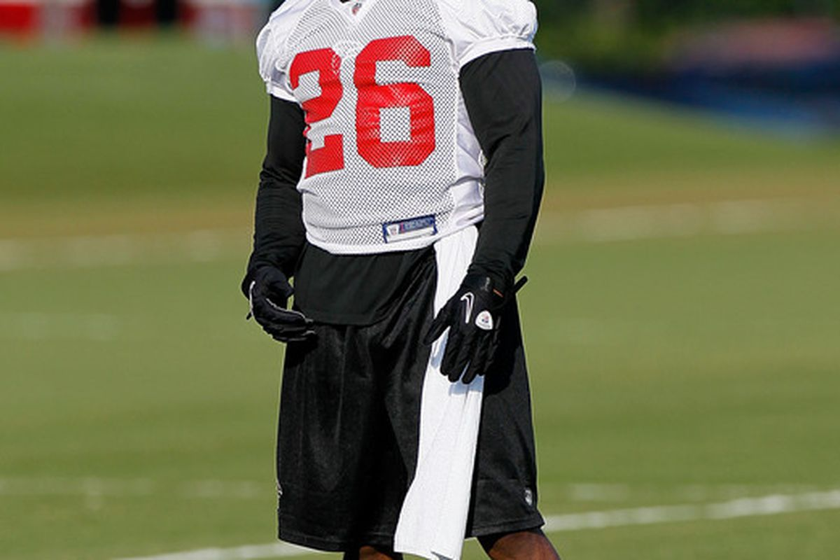 FLOWERY BRANCH GA:  Erik Coleman #26 of the Atlanta Falcons runs drills during opening day of training camp at the Falcons Training Complex in Flowery Branch Georgia.  (Photo by Kevin C. Cox/Getty Images)